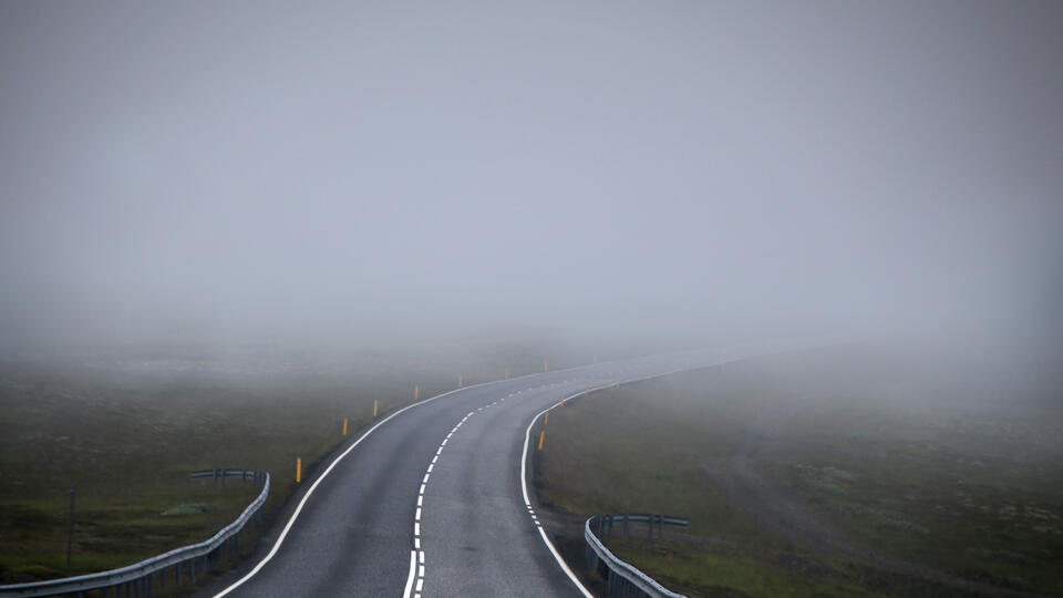 A road disappearing into fog
