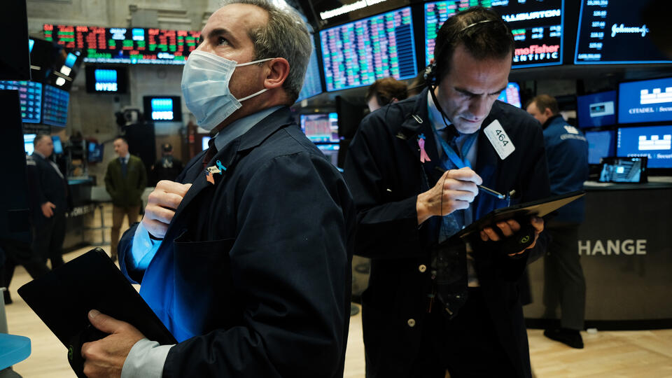 A trader wearing a mask on the floor of the New York Stock Exchange on March 20, 2020. Photo: Spencer Platt/Getty Images.