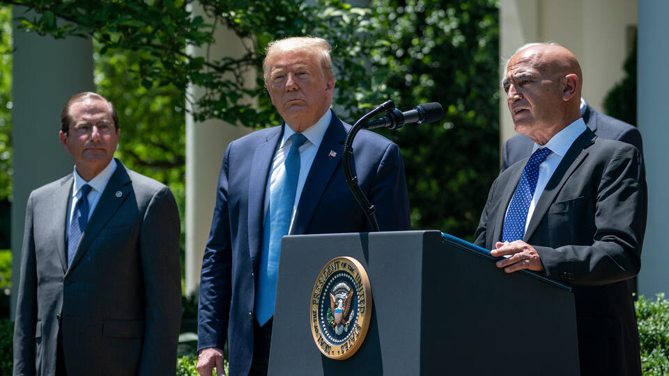 Moncef Slaoui, lead scientist on Operation Warp Speed, with President Trump and Health and Human Services Secretary Alex Azar at a press conference on vaccine development in May 2020. Photo: Drew Angerer/Getty Images.