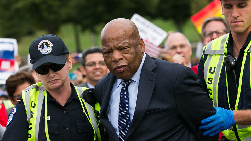 Congressman John Lewis is arrested for blocking traffic outside the U.S. Capitol at a protest in support of immigration reform in 2013. Photo: Drew Angerer/Getty Images.