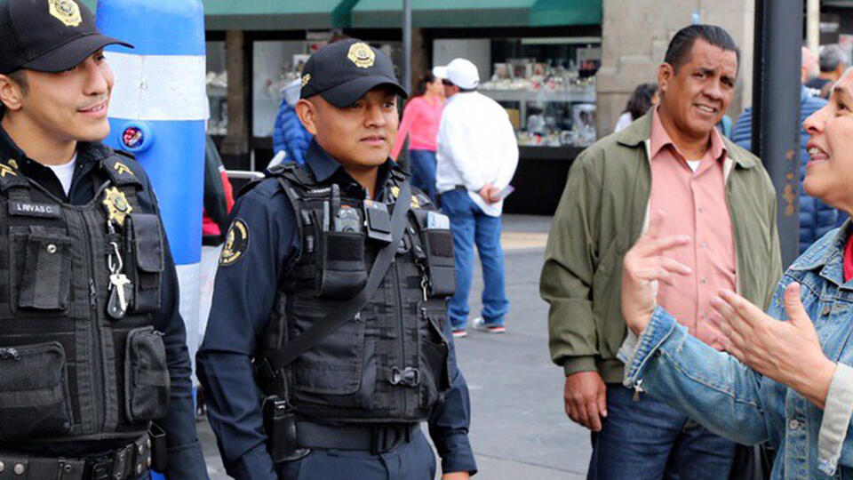 Police officers talking with citizens in Mexico