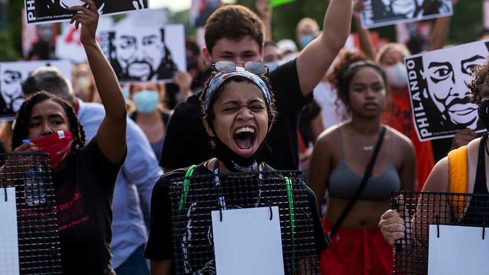 Demonstrators march in St. Anthony, Minnesota, on July 6, 2020, the fourth anniversary of the murder of Philando Castile. Photo: Stephen Maturen/Getty Images.