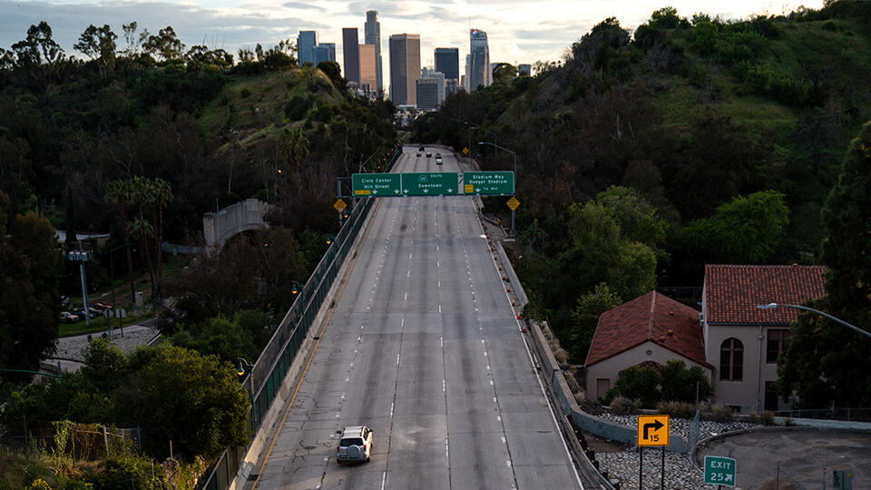 An empty Interstate 110 at rush hour in Los Angeles on April 10, 2020. Kent Nishimura / Los Angeles Times via Getty Images.