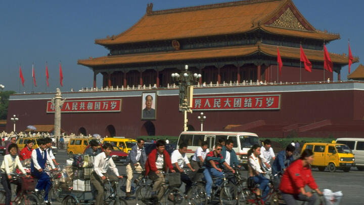 Traffic in Beijing's Tiananmen Square in 1995. Photo: Forrest Anderson/The LIFE Images Collection/Getty Images.
