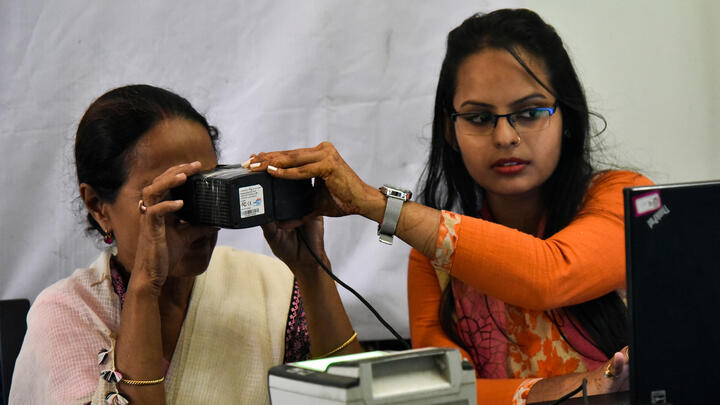 A woman having her eyes scanned at an Aadhaar registration office in Guwahati, India, in 2018. Photo: David Talukdar/NurPhoto via Getty Images.