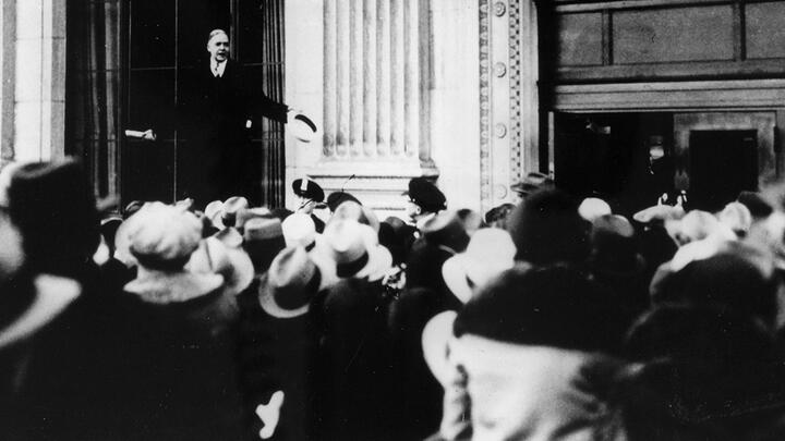 John Poole, president of the Federal American Bank, reassuring a crowd of anxious depositors in February 1931. Photo: Popperfoto via Getty Images.
