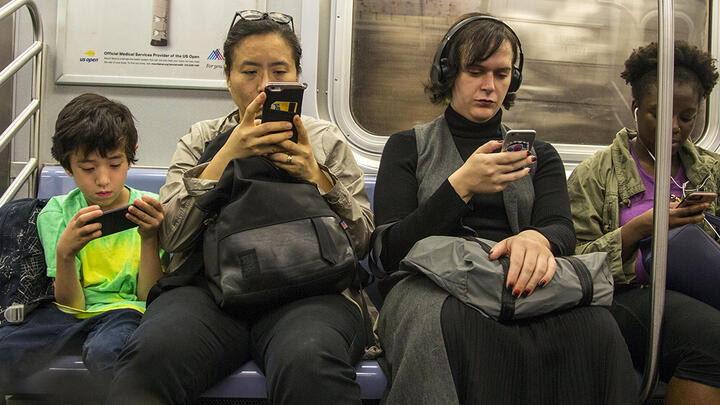 New York City subway riders using smartphones