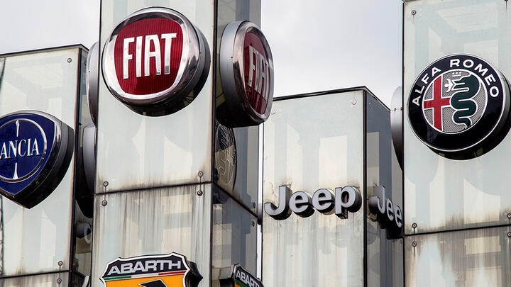 Fiat Chrysler logos at a car dealer in Turin, Italy.