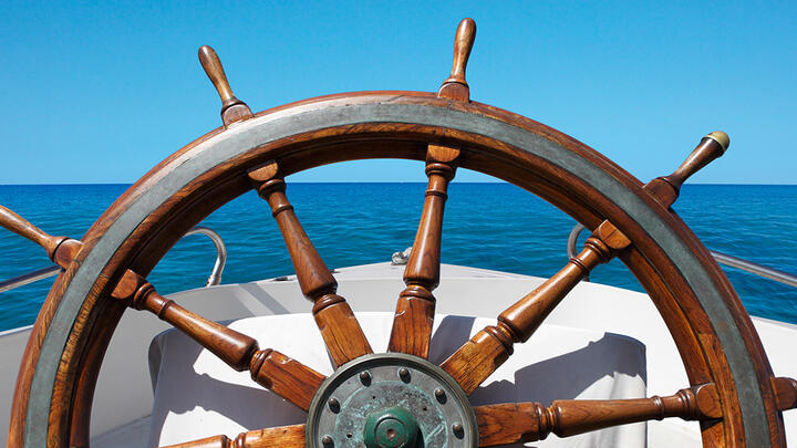 The helm of a boat at sea.