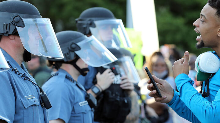 A demonstrator speaking to police officers during a protest on May 31, 2020, in Kansas City, Missouri. Photo: Jamie Squire/Getty Images.