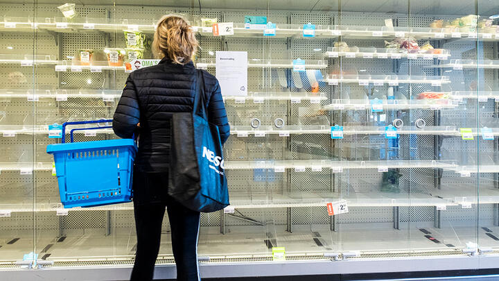 A shopper confronting empty shelves at a grocery store in Wassenaar, The Netherlands, on March 14, 2020. Photo: Michel Porro/Getty Images.