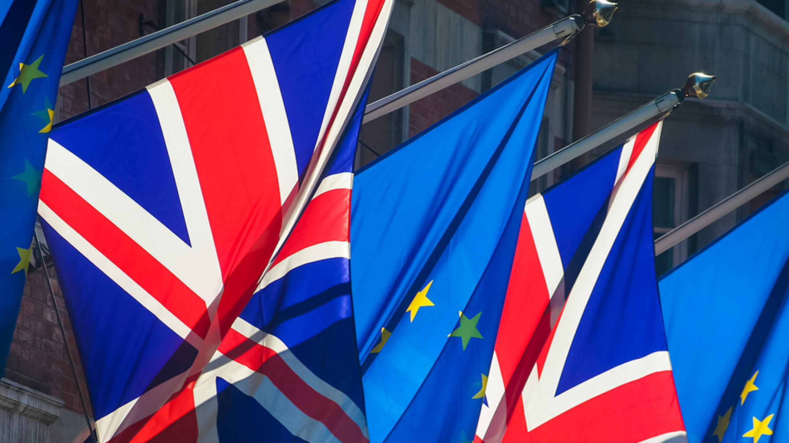 The flags of the UK and the EU