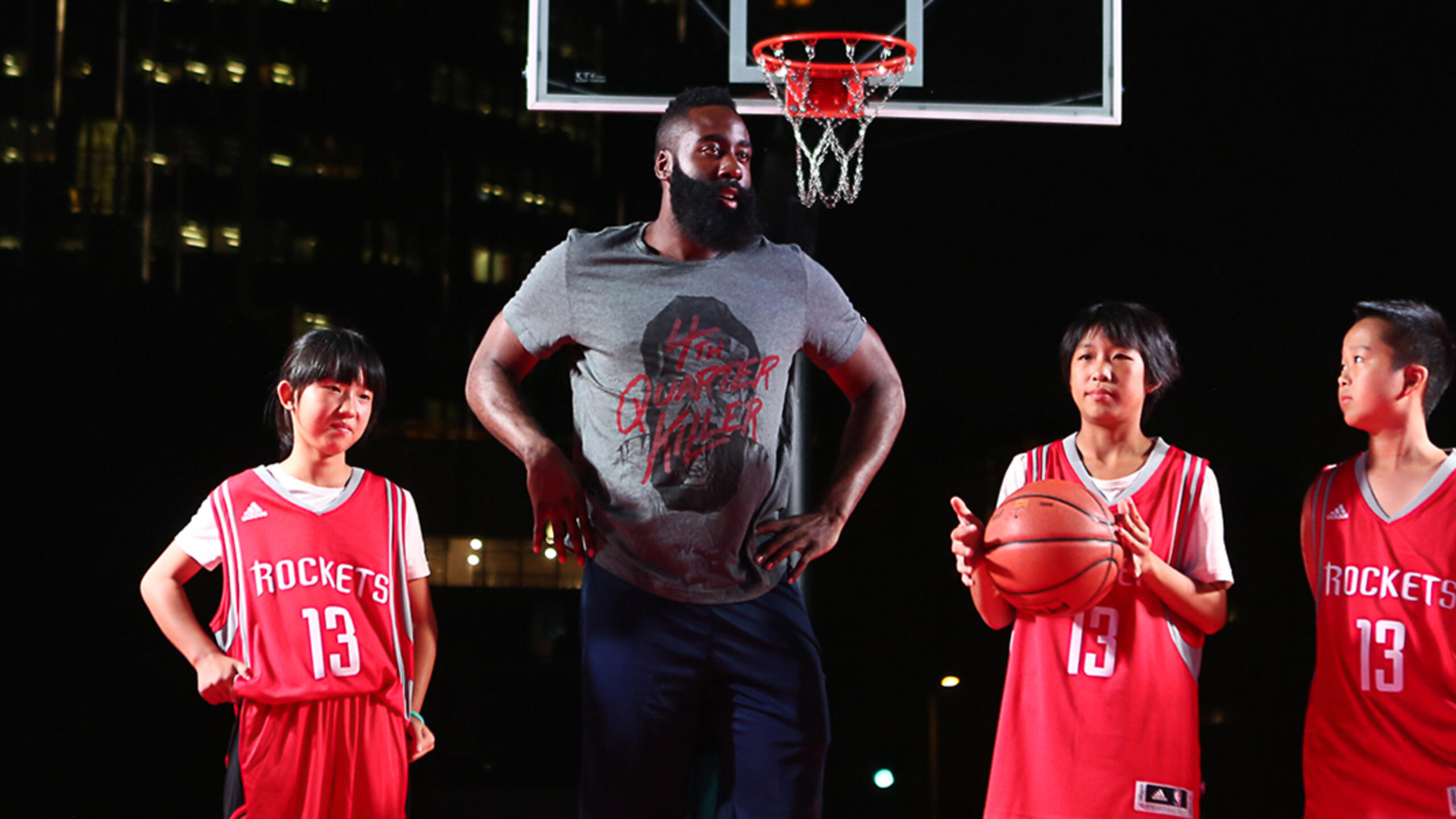 Houston Rockets star James Harden with young fans during a visit to China in 2016.