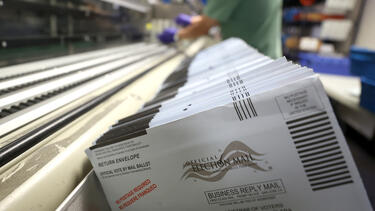 Ballots in a sorting machine at the Santa Clara County registrar of voters office in October 2020. Photo: Justin Sullivan/Getty Images.