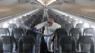 A contractor disinfecting a Frontier airplane at Denver International Airport in May 2020. Photo: AAron Ontiveroz/MediaNews Group/The Denver Post via Getty Images.