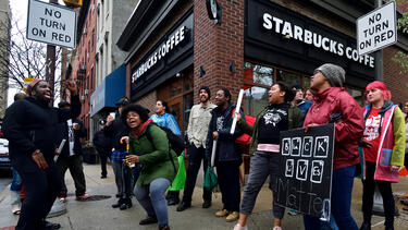 Protests sparked by the arrest of two Black men at a Starbucks location in Philadelphia in April 2018. Photo: Bastiaan Slabbers/NurPhoto via Getty Images.