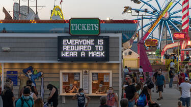 "A sign reading ""everyone is required to wear a mask"" at Playland's Castaway Cove, an amusement park in Ocean City, New Jersey, in September 2020. Photo: Alexi Rosenfeld/Getty Images."
