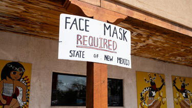 """A """"face mask required"""" sign at the Indian Village Gift Shop in Continental Divide, New Mexico, in August 2020. Photo: Bill Clark/CQ-Roll Call, Inc via Getty Images."""
