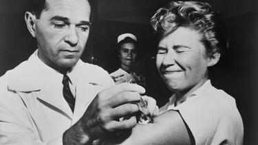 A nurse at Montefiore Hospital in New York City receives a flu vaccination in 1957. Photo: Everett Collection Historical/Alamy Stock Photo.