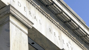 A detail of a photo of the Federal Reserve building