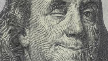 Benjamin Franklin on the $100 bill, winking