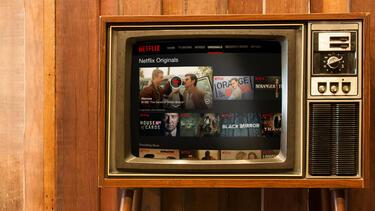 An illustration of Netflix on a vintage TV