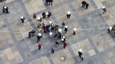A crowd seen from above with network nodes indicated