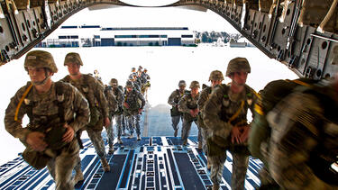 Soldiers boarding a transport plane