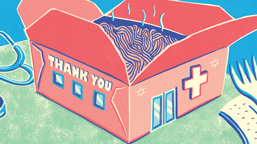 "A takeout box decorated to look like a hospital, with the text ""thank you"""