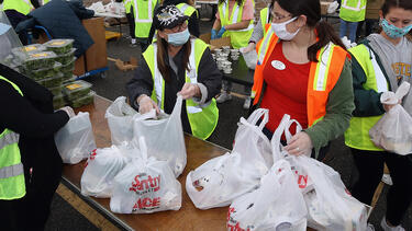 A food bank distributing food at an event on May 8, 2020, in Massapequa, New York. Photo: Bruce Bennett/Getty Images.