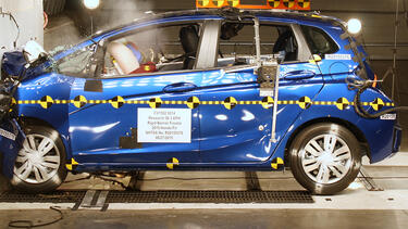 Honda Fit being crash tested into concrete inside a facility