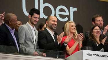 Uber CEO Dara Khosrowshahi, center, at the New York Stock Exchange during the company's IPO on Friday, May 10. Photo: Michael Nagle/Bloomberg via Getty Images.