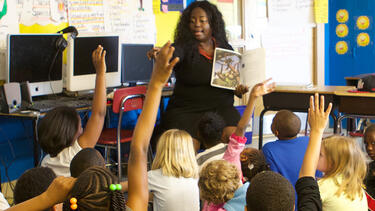 A teacher in a classroom.