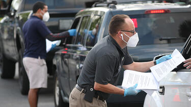 City employees handing out unemployment applications in Hialeah, Florida, in April 2020. Photo: Joe Raedle/Getty Images.