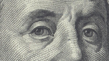 Detail of eyes from a $100 bill