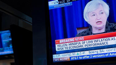 Janet Yellen, then chair of the Federal Reserve, on television monitors at the New York Stock Exchange in June 2014. Photo: Jin Lee/Bloomberg via Getty Images.