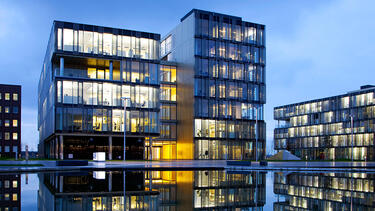 A photo of corporate headquarters campus reflected in water