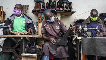 Cobblers wearing face masks at Kenyatta Market in Nairobi, Kenya, in April 2020. Photo: Patrick Meinhardt/Bloomberg via Getty Images.