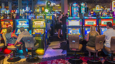 Casino floor showing several slot machines being played