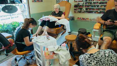 Workers and customers in a nail salon