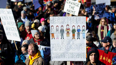 A protest before a Washington Redskins-Minnesota Vikings football game in Minneapolis in 2014. Photo: Hannah Foslien/Getty Images.