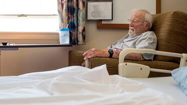 An elderly man in a nursing home