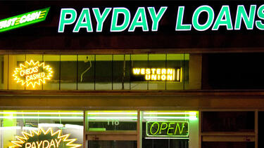 Signs in the window of a payday lending business