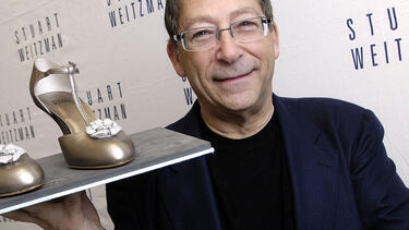"Stuart Weitzman with his diamond-studded ""Retro Rose"" shoe in 2008. Photo: Toby Canham/Getty Images."