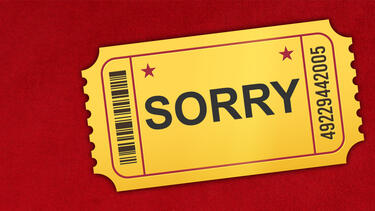 "A movie ticket with the word ""Sorry"" on it"