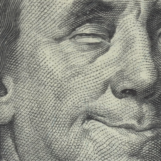 Benjamin Franklin on the $100 bill, winking